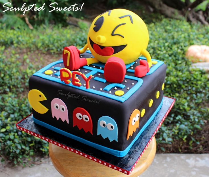 Pac-Man - Pac Man, the best video game ever! I made Pac Man out of cereal treats and the rest is fondant decor.