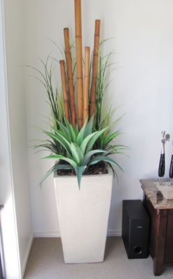 love this idea large planter bamboo poles agave and grass (plants artificial)