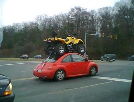 OMG - this totally something my husband would do!!!!  ATV strapped to a VW Beetles roof