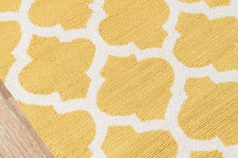 Quatrefoil yellow rug - Sky Iris top pick for yellow living room decorating.
