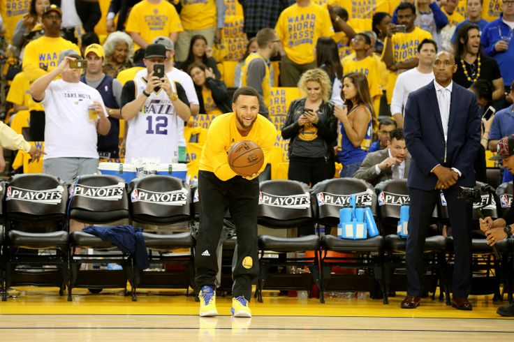 The Golden State Warriors' Stephen Curry (30) stands in a pitcher position as he prepares to throw the ball to teammate Ian Clark during warmups against the Utah Jazz before the start of Game 2 of their NBA second-round playoff series at Oracle Arena in Oakland, Calif., on Thursday, May 4, 2017.