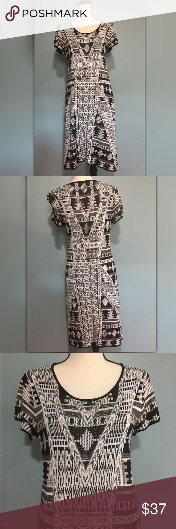 """Cynthia Rowley 'Aztec' Short Sleeve Knit Dress  Lg Cynthia Rowley 'Aztec' Short Sleeve Knit Dress sz Large   Originally $130.00 Great, pre-loved condition. Aztec print has brown, black, white and rose gold colors. See pic of closet up for more details on colors within print.  70% rayon, 30% cotton. Approx. 34"""" bust Approx. 40"""" length while on mannequin. Cynthia Rowley Dresses"""