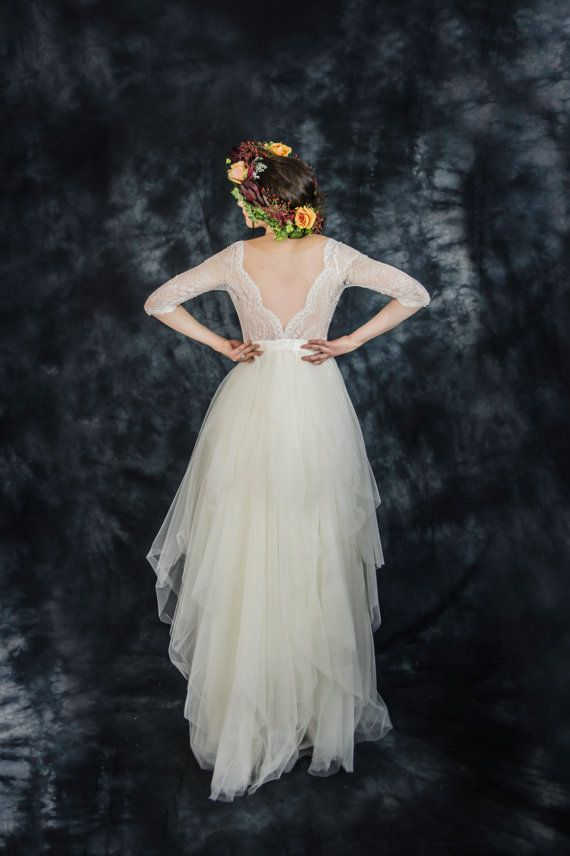 This dreamy ivory backless floor length wedding dress in silk, lace and tulle is perfect for summer weddings or destination weddings. If you are
