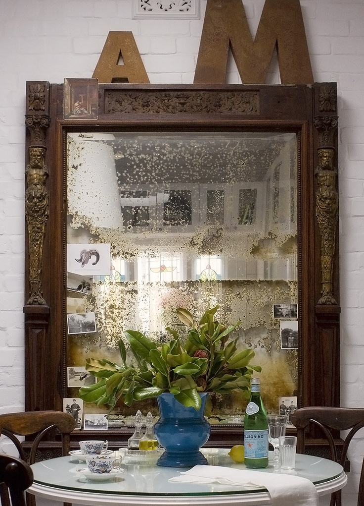 I love this mirror rescued from a fire in Kings Cross and fought over at auction. It once bore gold gilt 18th century relief work, somewhat battered now. I scrubbed the ashen surface with fine steel wool to bare the timber, but left the de silvered glamour of the mirror