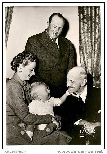 Princess Ragnhild of Norway and son Haakon visiting her father, Crown Prince (later King) Olav, standing, and grandfather, King Haakon VII, after whom little Haakon was named.  Both Haakons are really enjoying each other.