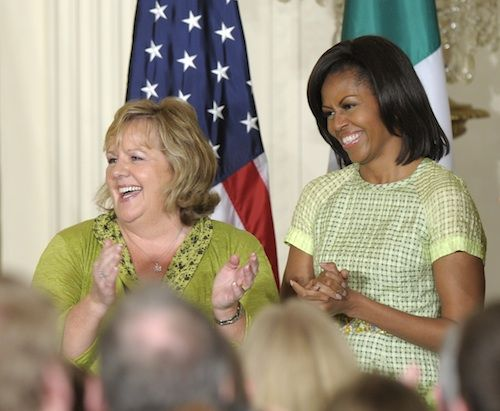 Mrs. O wearing a Spring 2012 dress by Lyn Devon.  She's with Fionnuala Kenny, wife of Irish Prime Minister Enda Kenny, for a St. Patrick's Day reception in the East Room of the White House.