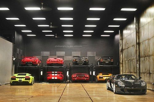Love the garage, but would totally switch out all those garish cars for…