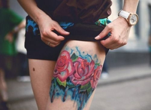 http://tattoomagz.com/roses-tattoos-on-legs/red-watercolor-rose-tattoo-on-leg/
