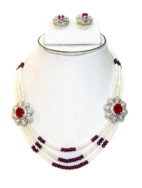 Maroon / Off White Stone Studded Necklace Set    Itemcode: JJR3194    Price: US$ 179.20    Click here to shop: http://www.utsavfashion.com/store/item.aspx?icode=jjr3194