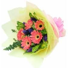 Pink gerberas bunch with multi-color paper packing and green leaves to add a natural beauty in this bouquet.