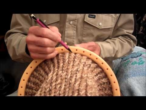 Loom Knitting - Hat, Beginner Tutorial (NOTE: Use a loom that fits your head and NOT the one used in the tutorial!... Make this pattern wider and longer to make a bag with a draw-string inserted in the rim.. Deb)