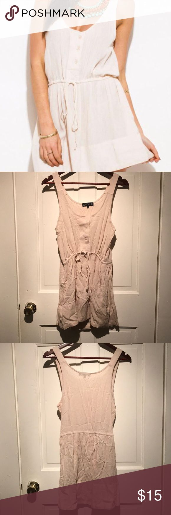 Sundress Wrinkly from packaging. Never worn. Hanger strings in tact. String at waist can be tightened or loosen. Buttons can be used. See through. Has pockets. 100% rayon. Dresses Mini