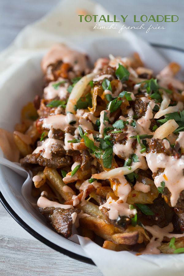 These totally loaded kimchi fries are the perfect flavor packed appetizer or main course. Crispy fries topped with melted cheese, seasoned beef and sautéed kimchi. So easy!