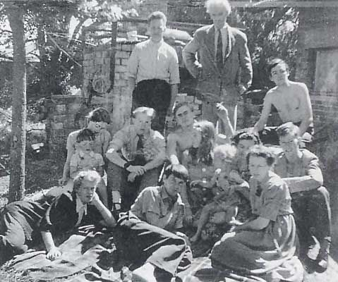 The Boyd family at their Murrumbeena Pottery Back row (L-R) Hatton Beck, husband of Lucy Boyd; Merric Boyd and David Boyd.  Centre row : Yvonne Boyd, wife of Arthur, with Laurence Beck, unidentified;  John Perceval: Mary Boyd, wife of Perceval and later Sidney Nolan;  Lucy Boyd with her son Robert on knee; Guy Boyd.  Front : Joy Hester, Arthur Boyd and Doris Boyd. c.1951