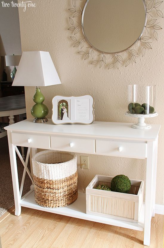 Divinely Organized says...This is classy and pretty, but my favorite part of this vignette is the painted basket.  #divinelyorganized  #ccc  neutral entryway