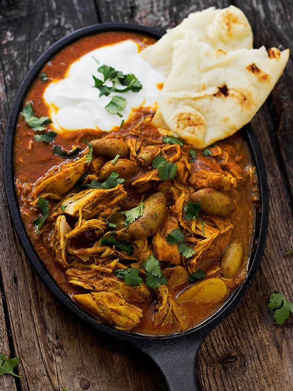 A hearty Indian Spiced Chicken stew with potatoes in a spicy tomato and cream sauce. Perfect served with yogurt and naan bread.