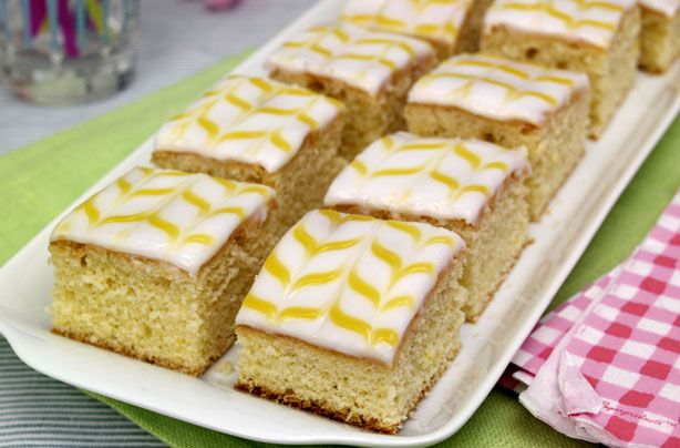 Lemon curd is delicious on toast - but it's great in cake too and a lovely way to decorate these zesty, bite-sized cakes.