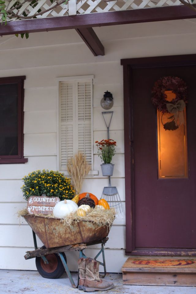 Fall porch | Decorate your front porch for Fall | Fall wheelbarrow decor | Fill a wheelbarrow with pumpkins, mums and hay | DIY Fall wreath |
