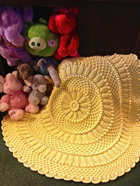 Crochet pattern, $5.00 on Ravelry.  Lille Matelassé Circular Baby Afghan pattern by Priscilla Hewitt.