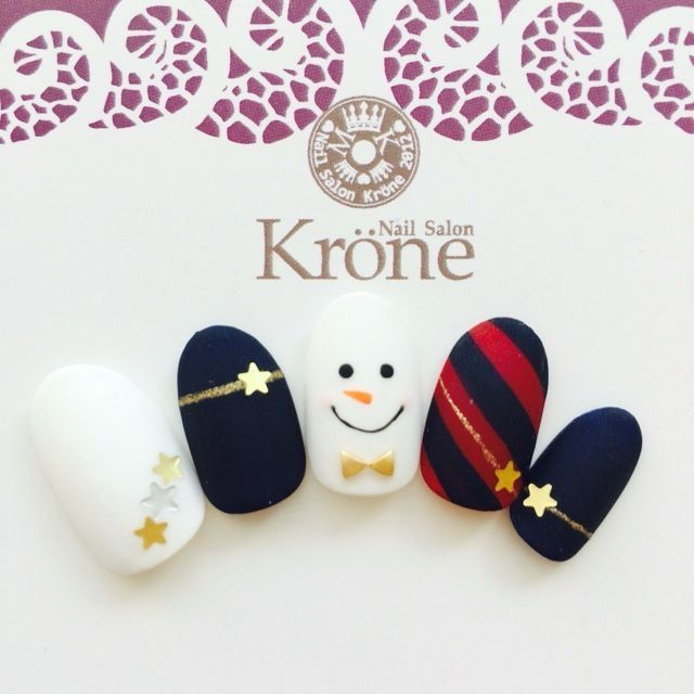 Shooting stars and snowman design for these festive nails - dark blue and red go well to create this classy seasonal manicure #makethemmelt...x