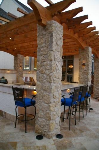 Outdoor Kitchen Pergola w/ stone columns and wrap around bar