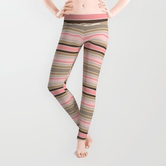Striped colors of a pink and beige conch sea shell patterned leggings