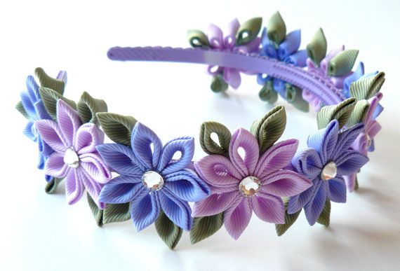 The flowers are made in the technique of tsumami kanzashi.   Flowers are made from grosgrain ribbons. Swarovski crystals.    At your request can be made a