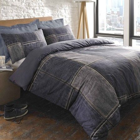 Patchwork of reclaimed - recycled denim transformed into bedding comforter and pillows.