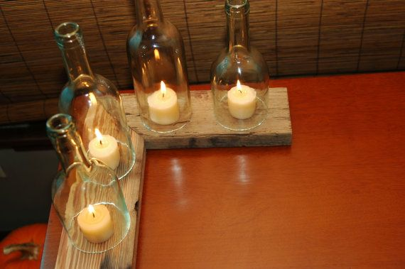Designed to fit (quite literally) just about any nook that could use a little ambiance, these modular candle holders offer the benefits of 5+ designs in one! So theyre not only beautiful, but also very functional as well!    Made from reclaimed heart pine, which has been coated in a non-flammable finish, and recycled wine bottles, this listing includes 4 wine bottle luminarias and 2 separate pieces of pine which may be rearranged and repositioned in pretty much anyway your heart desires. We…