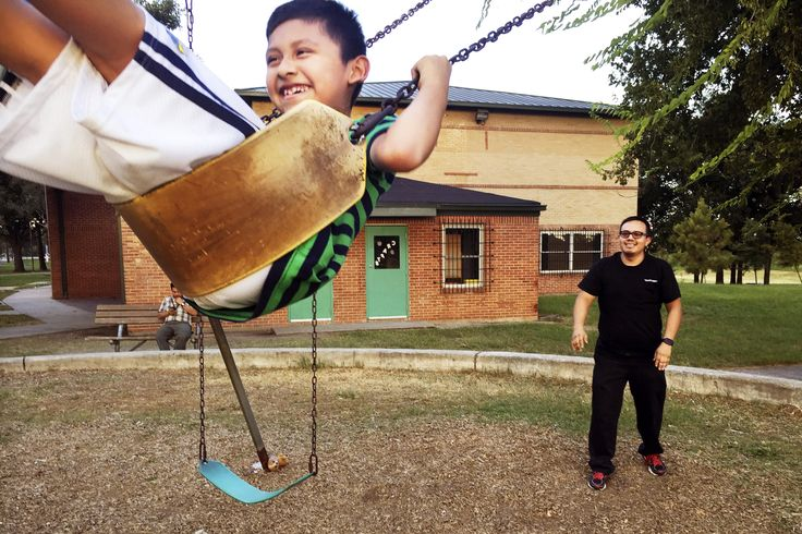 Fernando Aguilar plays with his 8-year-old son Isaac. He worries that Isaac isn't enrolled in the gifted and talented program in Houston.