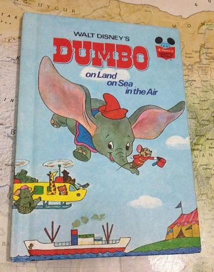 "Walt Disney's ""Dumbo"" : on Land on Sea in the Air Disney's wonderful world of reading  buku terbitan tahun 1972 hard cover kondisi 95% (kertas masih lurus seperti baru)  berceritakan tentang petualangan Dumbo mencari alternatif transportasi menuju ke Boston bersama rombongan sirkus. banyak keseruan yang terjadi di dalam cerita, juga dapat mengenalkan anak-anak jenis transportasi yang ada. Dengan ilustrasi klasik khas Disney, grammar yang digunakan juga mudah untuk di ucapkan dan di fahami…"