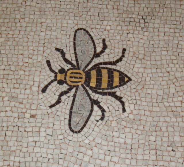 Bee mosaic. The bee is the symbol of efficient industry and figures in the coat of arms of Manchester. This is on the first floor of Manchester Town Hall, outside the door of the Great Hall.