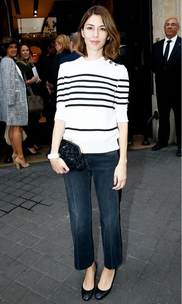 Sofia Coppola in a striped sweater, denim and rounded-toe heels.