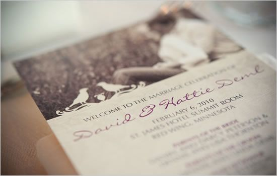 Wedding invitation with a picture of the couple.