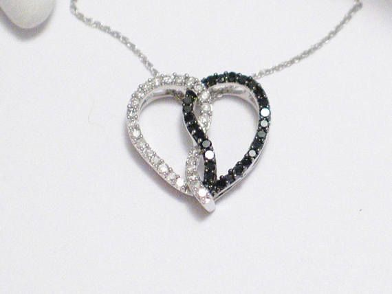 Yin yang black white diamond open heart pendant charm Solid 10k white gold . Great gift for interracial love or the symbolic half good heart and dark heart, this heart can symbolize many things :) But whatever it may represent to you it displays beautifully with shimmery white and black diamonds :) #jewellery #jewelry #heart #love #valentine #necklace #pendant #womens #diamond #yinyang #interraciallove #gold