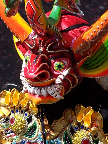 via www.mountainadventures.com  La Paz, Bolivia. Close-up of mask on a dancer in the Festival del Gran Poder.