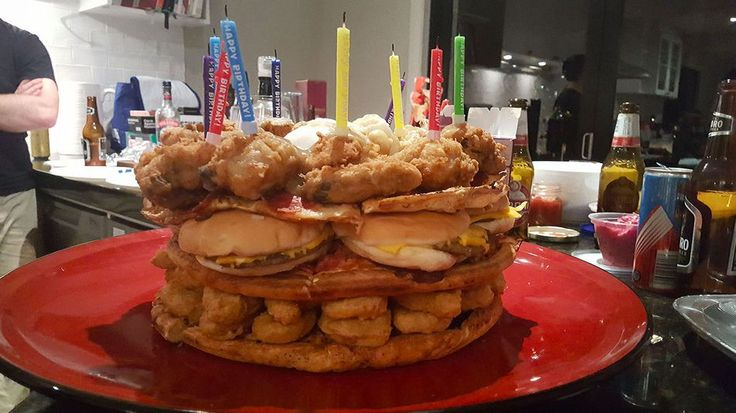 A fast food birthday cake is a truly epic creation. Domino's pizza, McDonald's nuggets, fries, and burgers, some KFC, topped off with potatoes and gravy.