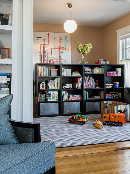 Victorian Kids' Room With Free Standing Ikea Record Shelves, Grey Canvas Bins, Stripe Rug And Stripe Toy Storage Bin