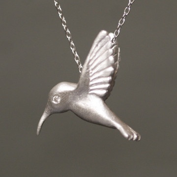 Hummingbird necklace. Silver with diamonds. By Michelle Chang. Handmade in NYC.