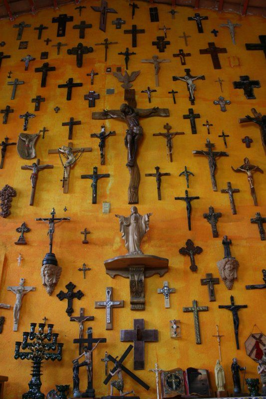 collection of crucifixes & crosses -- Catholic wall art.  My parents have a similar wall.  I've started one myself.