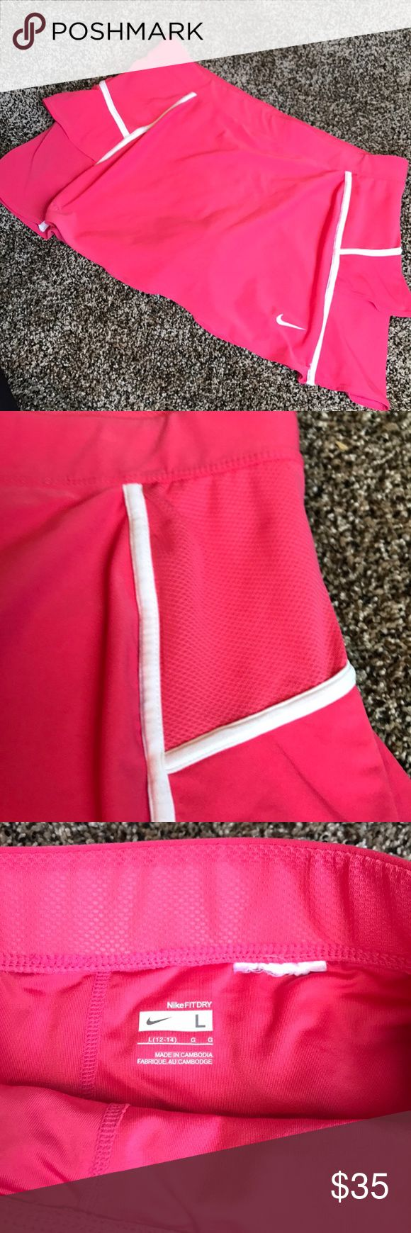 Like-New Nike Tennis Skirt. GREAT CONDITION...worn once or twice. Note: Care tag is cut out bc it scratch when playing. Size tag is stamped in (pictured). Built in shorts. Mesh and ruffled details. Nike Skirts