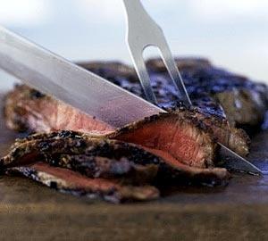 Knife slicing steak (© Mary Ellen Bartley/Getty Images)
