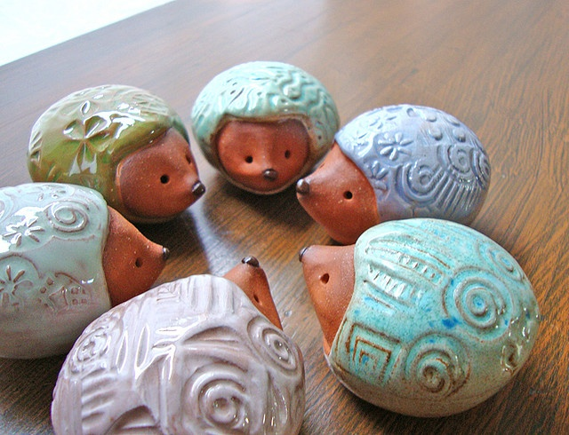 handmade clay  hedgehogs by Ferragamo Studio, via Flickr. Would make a great rattle.