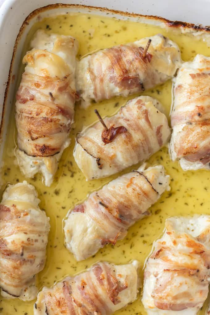 These CHEESY PANCETTA WRAPPED CHICKEN ROLLUPS are so quick and easy and delicious! Chicken stuffed with boursin cheese and wrapped in pancetta makes for the most moist and delicious chicken ever.