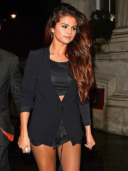Star Tracks: Tuesday, February 18, 2014 | NIGHT WALK | Looks at those legs for days! Selena Gomez sports some short-shorts while out in London Monday night.... - Selena Gomez Style