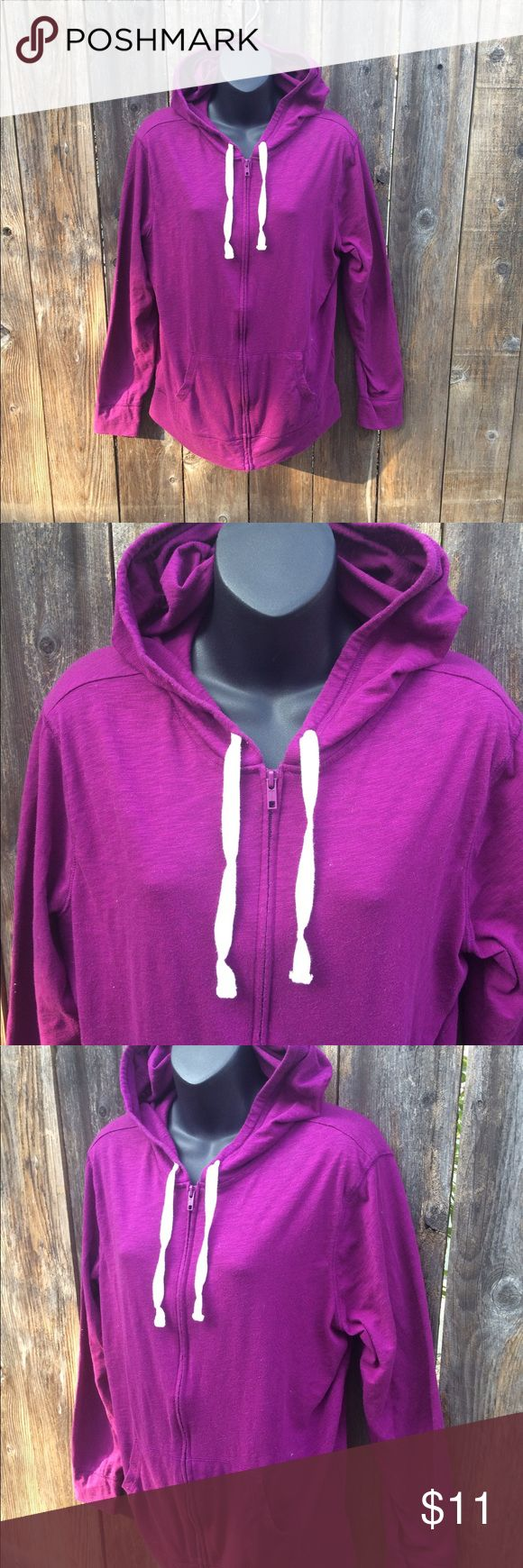 Gap jewel toned purple zip up hoodie Purchased from another seller who said they only wore it once. I have only washed it. Picture made it look Burgundy and it's a bright pretty purple. I unfortunately am boring and wear more muted colors. Haha. Zip up with hood. Tag has been cut out. The brand is Gap, size large.  Any discoloration at bottom is from the lighting. It is not flawed. GAP Tops Sweatshirts & Hoodies
