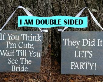 """""""They did it! Let's party!"""" on the other side of ringbearer sign for the walk out"""