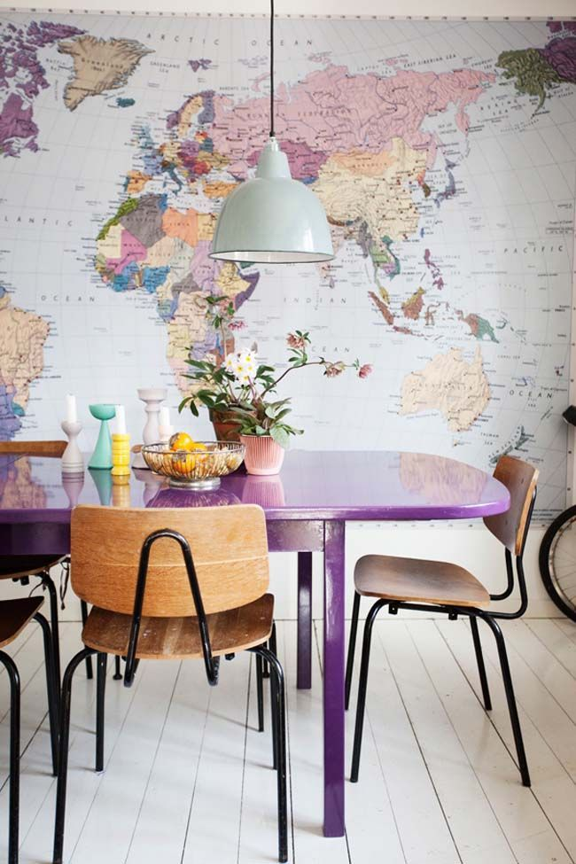 Huge World Map (and Purple Table) in the Dining Room / Kitchen. Love how  they made the dining table tie in with the purple in the map.