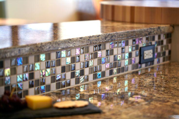 purple & teal mosaic tile backsplash -