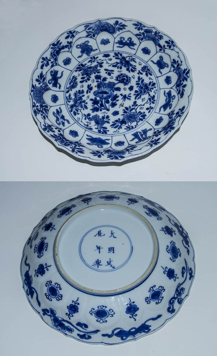 A chinese  porcelain dish with blue underglaze decoration; probably made in Jingdezhen for export to NW Europe  during the first decade of the realm of the Kangxi emperor; The  six-character Chenghua mark on the glazed foot area is  apocryphal . a circle of radiating panels, molded in petal-shape on the cavetto, surround a central flower display; the panels show pictures of the eight buddhist emblems alternating with small flowers.